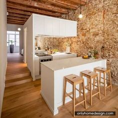 Sergi Pons Uncovers Stonework And Ceiling Vaults In Renovated Barcelona Apartment - http://www.onlyhomedesign.com/interior-designs/sergi-pons-uncovers-stonework-and-ceiling-vaults-in-renovated-barcelona-apartment.html