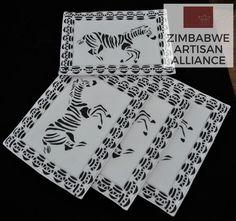 """Black and White Zebra Print Placemats"" Zimbabwe Textiles Setof4 hand printed Africanplacemats.  TheseplacematsarehandprintedbyZimbabweanwomenwhoworkfrom home. TheirwaresarethensoldattheAvondaleMarketinHarare, Zimbabwe.  This set was made by the artist Patricia."