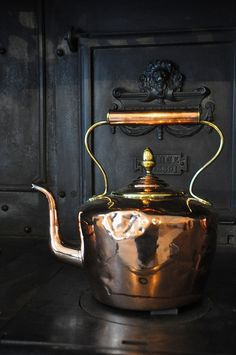 Copper teapot on cast iron stove; posted at Content in a Cottage blog
