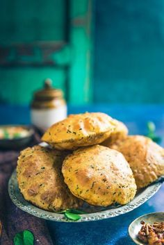 Combined with the goodness of fresh methi leaves, ajwain, curd and basic spices, Dahi Methi Poori turns out as a clear winner during any meal. #Vegetarian #Indian #Bread #Fenugreek #methi