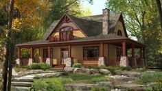 Rustic exterior with transom windows and chunky stone columns. Master bedroom has a bonus private balcony #craftsman bit.ly/1kIg6Wb