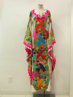 Beautiful Hand Embroidered Mexican Dress from the State of Jalisco. $1,995.00, via Etsy.