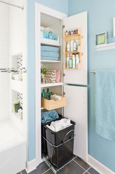 Linen Closet- like the idea of room for laundry baskets on the bottom