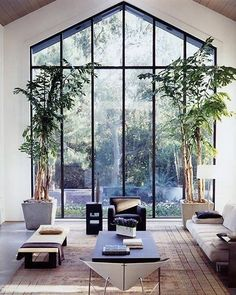 Love this Zen inspired room we found on Pinterest. The slim metal frames of the double height window are really on trend at the moment creating a modern window with an industrial edge #LetTheLightIn #HugeWindow #Nature #NatureLover #Views #Window #InteriorInspiration #Design #Minimalistc #Minimal_Perfection #architecturalglazing #metalframes #industrialwindow #steelwindow #doubleheightwindow #architecturalglass #interiordesign #architecture #zendesign #zenroom