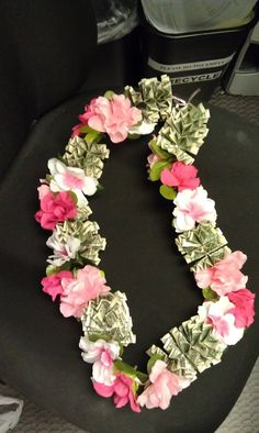 This is the money lei I made.  You can make it with as much cash as u like. This one has $30 on it.