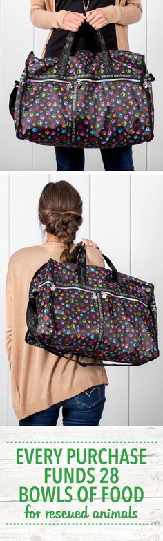Take your love for your four-footed friends with you wherever you go with this classic roomy travel bag. Featuring black woven handles and an adjustable shoulder strap, rainbow-hued zippers complete with paw print charms dangling from the ends, inside and outside pockets, and a removable zippered coin purse.