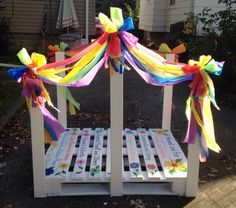 Bridge for Girl Scout crossing over ceremony - made with an old wood pallet, six pieces of 1x4 wood, 6 plastic table cloths, white semi-gloss paint and paint markers