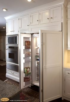 appliance panels integrate the large refrigerator into the setting. White Kitchens, White Kitchen Cabinets, Kitchen Appliances, Kitchen Ideas, Kitchen Decor, Kitchen Design, Windsor Doors, Sage House, Attic Bedrooms