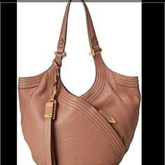 """✨orYANY✨ - Italian Leather Hobo Bag Style: Medium Tracy -!Great Condition! Color: Mushroom.  Italian leather, double handles, tassel detail, magnetic closure, dog leash hook center closure, front and back zipper pockets, goldtone hardware Lined interior, two back-wall zipper pockets, two front-wall slip pockets, one front-wall zipper pocket Measures approximately 12""""W to 15-1/2""""W x 9-1/2""""H x 2""""D with a 12"""" strap drop; weighs approximately 1 lb, 12 oz Body/trim 100% leather; lining 100%…"""