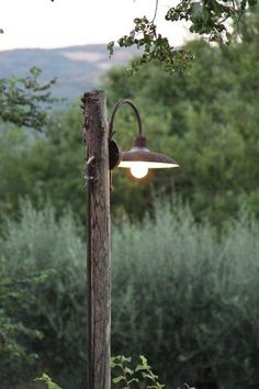 Wooden light post patio pinterest light posts lights and oldfarmhouse summersfall pinterest httppinqjhfmvl mozeypictures Image collections