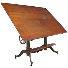 I love old drafting tables with cast iron bases!