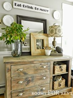 Farmhouse style. Love the distressed repurposed dresser. Gorgeous decor. My kitchen please.
