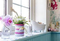 bathroom windowsill with crochet jar cover and flowers
