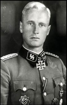 "The type of warrior Himmler wanted in the SS: blond with full ""Aryan"" characteristics. In this case SS-Sturmbannführer (later SS-Standartenführer) Max Hansen (1908 - 1990) who commanded II./1.PzGren Regiment, Panzer Grenadier Division ""Leibstandarte-SS-Adolf-Hitler""."