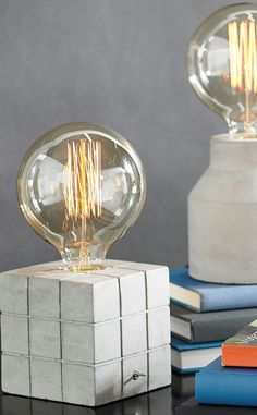 Sometimes a lamp isn't entirely about illumination – our Cement Table Lamps are largely about style, offering up an unusual combination of modern, substantial bases with old-school, delicate light bulbs.