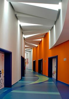 Children's Rehabilitation Centers Teleton  Ceiling detail: use primary colors with a hop-scotch pattern on the floor. The doors can have the cartoon-ish looking features to distract  from the typical hospital look.