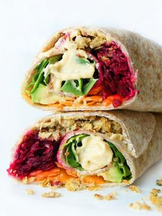 These vegan and gluten-free rainbow falafel wraps are packed full of colour, flavour and nutrients! Whip up a batch of falafels ahead of time and assemble these wraps throughout the week for a quick, easy and healthy meatless meal! Falafel Wrap, Healthy Wraps, Vegetarian Recipes, Healthy Recipes, Wrap Recipes, Fish Recipes, Galette, Wrap Sandwiches, Clean Eating Snacks