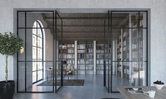 crittall style glass partition with pivot doors and panels Flush Doors, Pivot Doors, Glass Hinges, Sliding Glass Door, Bari, Glass Room Divider, Italy House, Sliding Door Systems, Glass Partition