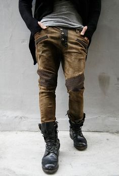 black-commando-boots-not-so-tightly-laced-patched-frankenstein-jeans-leaning-on-wall