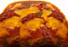 This is a Texas style chili without beans.  However, you can add any beans that you like.    You can garnish with shredded cheese, diced onions or whole chili peppers.