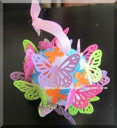 Butterfly ball - styrofoam ball + ribbon + craft punch butterflies and glue