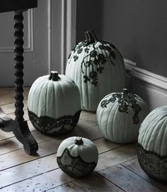Part cobweb, part creeping vine, the effect of black lace on painted #Halloween #pumpkins is thoroughly macabre.