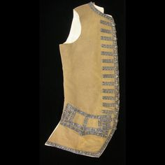 Waistcoat, England, 1740-1765. Brown ribbed silk, trimmed with silver woven tape or galloon.