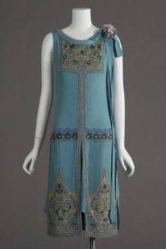 Wedding dress, 1927. Silk crepe, glass beads, metallic thread embroidery. Maker unknown. Gift of Robert C. Woolard. 1991.408a Sponsored by Laura Barnett Sawchyn Chicago History Museum