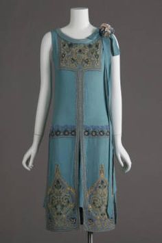 Wedding dress, 1927. Silk crepe, glass beads, metallic thread embroidery. Maker unknown. Gift of Robert C. Woolard. 1991.408a Sponsored by Laura Barnett Sawchyn Chicago History Museum