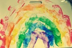 Rainbow Art using footprints. Uses whole body movement, teaches colours with kinesthetic learning and is fun.**Each child could be a different color. Use big butcher paper to make a beautiful rainbow.
