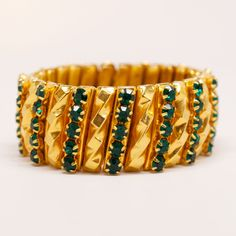Unsigned 1940's Gold Gilt Bracelet with Green Detail  Stretches with accordion style links. Green crystals are prong set.  #mdvii #1940s #bracelet #green