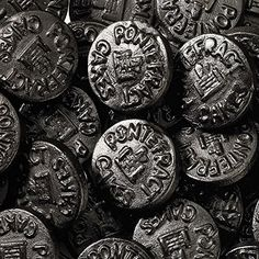Pontefract cakes are thick liquorice discs which were originally manufactured in the Yorkshire town of the same name. Supposedly dating from as early as the century, the cakes are traditionally stamped with an image of Pontefract Castle. Yorkshire Food, Yorkshire Towns, Pontefract Cakes, Murray Mints, Old Sweets, British Sweets, Wine Gums, Sherbet Lemon, Remember Day