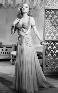 INTERRUPTED MELODY(1955)  starring Eleanor Parker.  This is 50s Hollywood's version of exotic India, although red-head Eleanor looks nothing like an exotic Indian maiden.