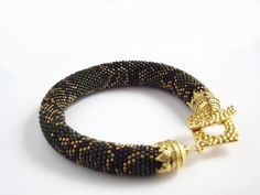 "Bead Crochet Bracelet "" Python"" Black Bronze patina  Jewelry  Beadwork  Snake  Gothic  Made to order by LeeMarina on Etsy https://www.etsy.com/listing/118103538/bead-crochet-bracelet-python-black"