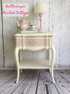 "Sold! Pretty in Pink! Darling French provincial nightstand painted in a light pink and antique white. One drawer, beautiful curvy legs and a shelf for extra storage. Dimensions: 26"" tall. 22"" wide and 16"" deep. Available for $95. Pickup in Hanford CA. Local delivery available for additional charge."