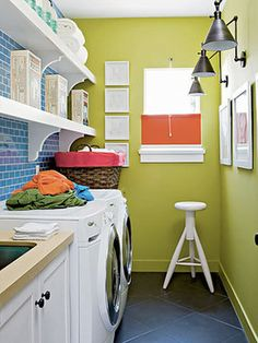 laundry room. shelfing! tile behind shelves. I lime the idea of the tile but not the green paint