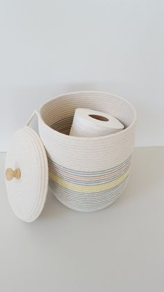 This sturdy yet flexible basket was made of natural white cotton rope and stitched with teal, yellow, and a smidge of orange thread. I finished it with a lid and an unfinished wooden knob for a handle. You can paint it, stain it, or leave it as is. Use this happy basket for legos,