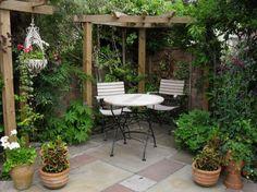 Courtyard Garden Design for Modern Home: Small Courtyard Gardens Design Corner Pergola Outdoor Dining Set ~ buymyshitpile.com Garden Houses Inspiration