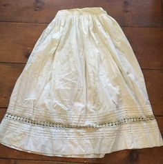 Looks like this is a mid Victorian piece or later by a few decades, that had the elastic inserted later as an alteration.