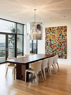 Nob Hill Penthouse showcases sophisticated interiors. The dining room table was custom designed by Bo Hagood with Made Inc. The artwork was a commissioned piece by an artist in Palm Springs named Downs.