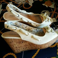 [Size 8, but fit like 7] Cream Wedges Very nice! They have sort of a nautical feel, also: THESE RUN SMALL, these are a size 8, but I wear a size 7 and they fit me. Shoes Wedges