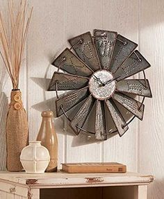 Inspired by a classic farm landmark, this Metal Windmill Wall Clock is the perfect coordinating piece for your country decor. Each blade has the hour embossed in Roman numerals, as well as contrasting hour and minute hands so you can easily read the time. Diy Home Decor Rustic, Country Farmhouse Decor, Rooms Home Decor, Easy Home Decor, Country Primitive, Country Art, Farmhouse Style, Primitive Decor, Room Decor