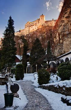 ღღ Austria - Salzburg: Medieval Glow ~~~~   The Hohensalzburg Castle glows in the first of a winter morning rays, high above the old town of Salzburg.    The Hohensalzburg Castle is a castle in the Austrian city of Salzburg. With a length of 250 meters and a width of 150 meters, it is one of the largest medieval castles in Europe.