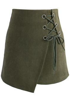 Step up your miniskirt collection with this lace-up army green piece. Its asymmetrical flap and jumbo lace-up detail makes it a fun party piece. Pair with your favorite turtleneck, a leather moto jacket, stockings and boots for an edgy yet sophisticated look.  - Lace-up decoration - Concealed back zip closure - Lined - 100% Polyester - Hand wash  Size (cm) Length Waist  Hip  XS        40    66 ...