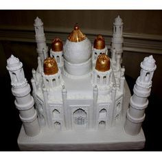 A confectionary wonder, the entirely edible Taj Mahal cake was created over a two-week period to honor the bride and groom's Indian heritage. Cardboard mailing tubes provided the form for the brick-patterned gum-paste towers that surround this 65-pound white velvet cake with fresh key lime filling.