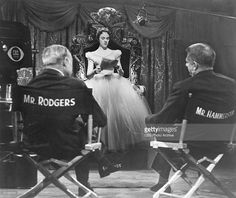Telecast American composers Richard Rodgers (1902 - 1979) and Oscar Hammerstein II (1895 - 1960) watch British actress Julie Andrews (as Cinderella) read her script on the set of the CBS Television presentation of their musical 'Cinderella,' New York, New York, March 22, 1957. (Photo by CBS Photo Archive/Getty Images)