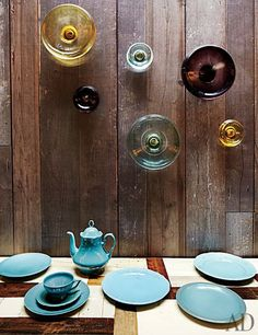 Overscale glass knobs and brightly colored tableware at Tom Dixon Shop.