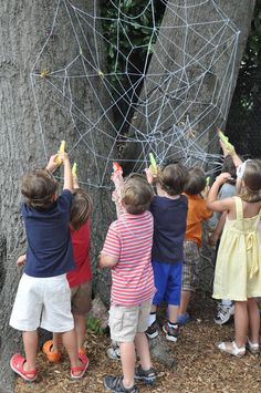 The Little Nook: Spider Man party game - Knock the spiders off the web with water guns.