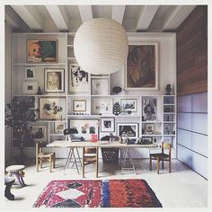 What an awesome way to display photos, paintings & knick knacks! Some of the bigger shelf spaces house two paintings side by side. Each shelf space displays a memory, like a shop shelf of personality. Such a creative idea!