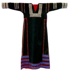 Object:Dress Size (cm):133 x 70, plus 2x sleeves 47 Place of origin:Saudi Arabia Region, group, style:Southern Date of object:1980's Category:Torso and legs Techniques:Applique, beading, embroidery  Narrow black dress with side gores. Heavy beading around yoke, sleeve heads and cuffs. Lower hem decorated with applique bands in blue and embroidered in a red zig-zag design.